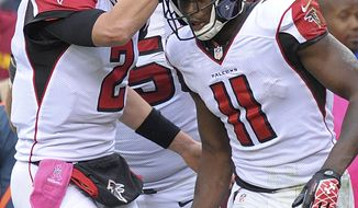 Atlanta Falcons quarterback Matt Ryan congratulates wide receiver Julio Jones on his touchdown during the second half of an NFL football game in Landover, Md., Sunday, Oct. 7, 2012. (AP Photo/Susan Walsh)