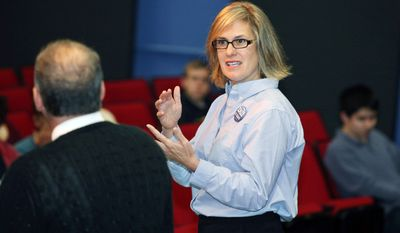 Maine's Democratic U.S. Senate candidate, Cynthia Dill, speaks to teacher Ted Jordan's high school government class Tuesday in Cape Elizabeth. (Associated Press)
