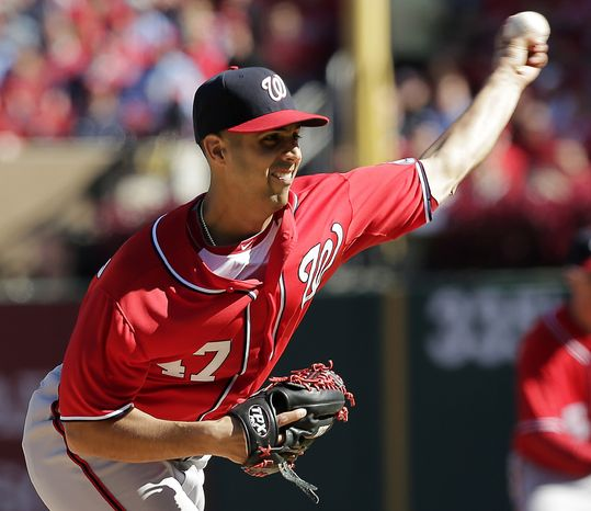 Washington Nationals pitcher Gio Gonzalez throws during the first inning of Game 1 of the National League division baseball series against the St. Louis Cardinals, Sunday, Oct. 7, 2012, in St. Louis. (AP Photo/Charlie Riedel)