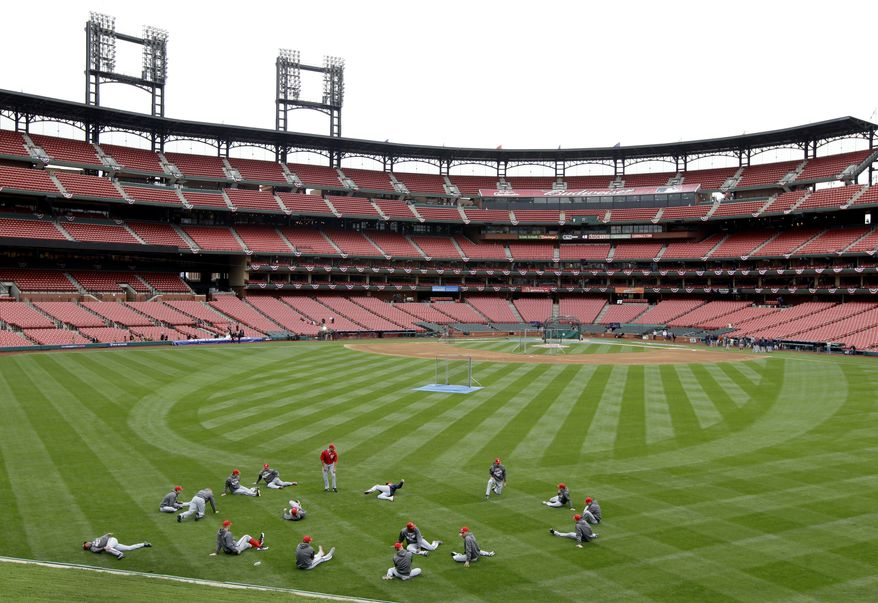 Members of the Washington Nationals stretch at the start of baseball practice inside Busch Stadium, Saturday, Oct. 6, 2012, in St. Louis. The Nationals and the St. Louis Cardinals are scheduled to play Game 1 in the National League division series on Sunday. (AP Photo/Jeff Roberson)