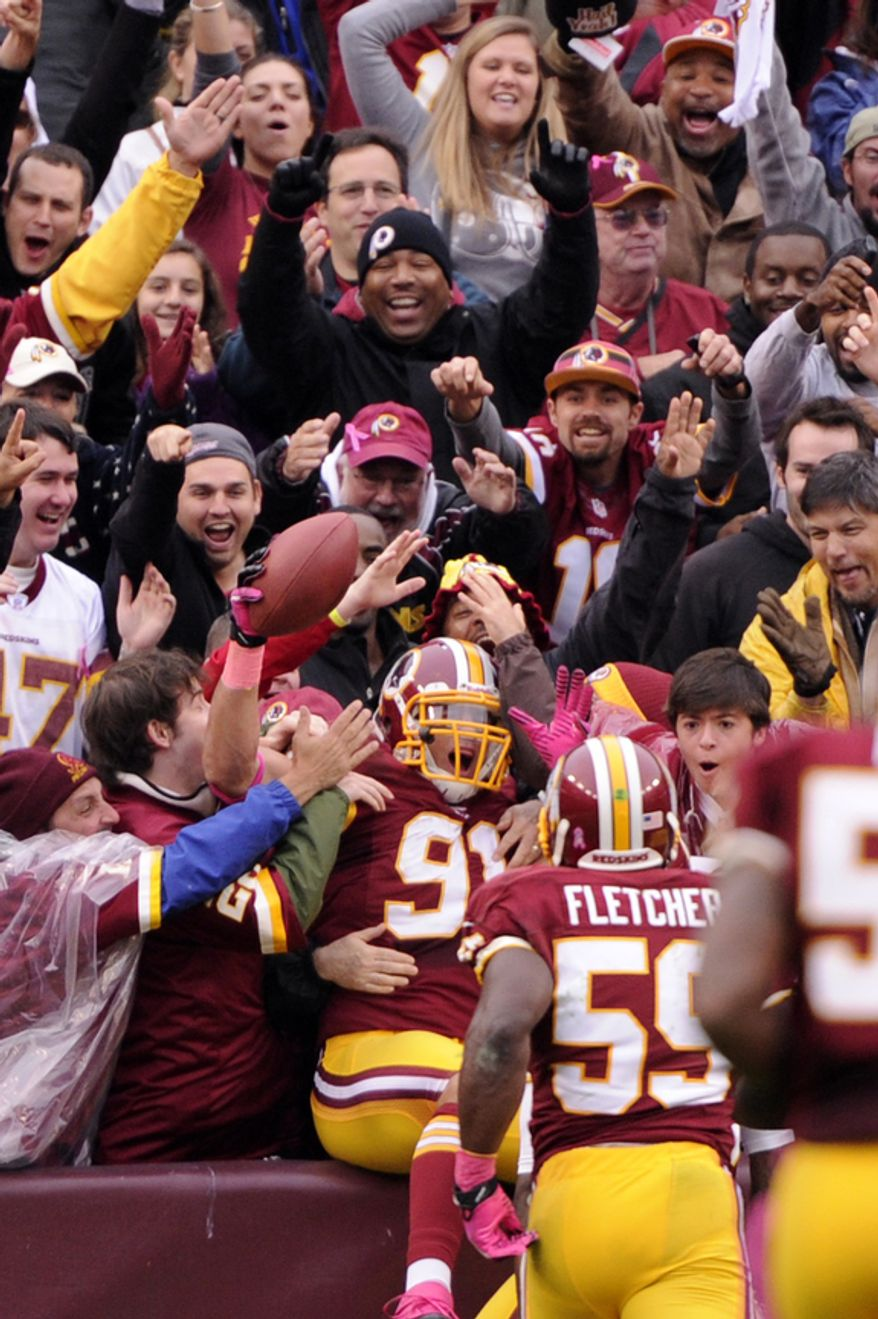 Washington Redskins outside linebacker Ryan Kerrigan (91) celebrates his touchdown after intercepting the ball in the first quarter at FedEx Field, Landover, Md., Oct. 10, 2012. (Preston Keres/Special to The Washington Times)