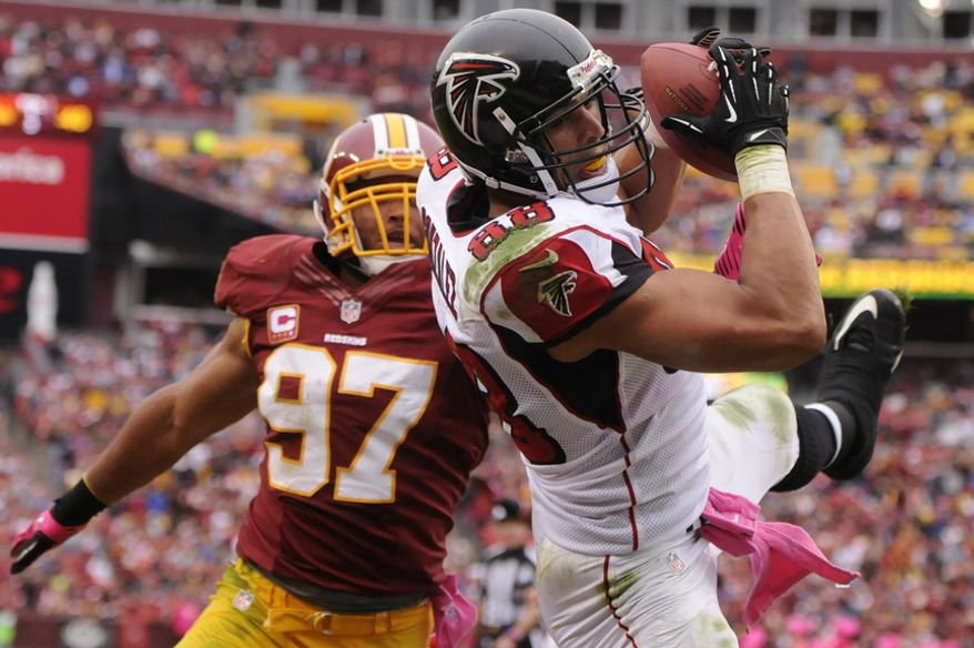 Atlanta Falcons tight end Tony Gonzalez (88) hauls in a second quarter touchdown in front of Washington Redskins linebacker Lorenzo Alexander (97) at FedEx Field, Landover, Md., Oct. 10, 2012. (Preston Keres/Special to The Washington Times)