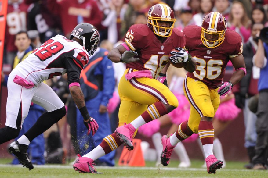 Washington Redskins running back Alfred Morris (46) runs past Atlanta Falcons free safety Thomas DeCoud (28) for a first down in the first quarter on his way to 115 yard game at FedEx Field, Landover, Md., Oct. 10, 2012. (Preston Keres/Special to The Washington Times)