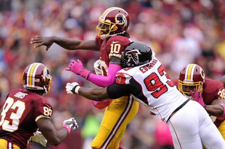 Washington Redskins quarterback Robert Griffin III (10) is rushed by Atlanta Falcons defensive end Ray Edwards (93) as he throws from the pocket in the second quarter at FedEx Field, Landover, Md., Oct. 10, 2012. (Preston Keres/Special to The Washington Times)