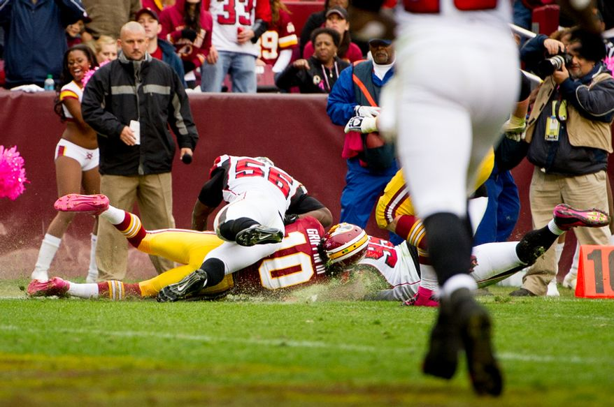 Washington Redskins quarterback Robert Griffin III (10) is hit hard by Atlanta Falcons outside linebacker Sean Weatherspoon (56) in the third quarter and would leave the game as the Washington Redskins play the Atlanta Falcons at FedEx Field, Landover, Md., Sunday, October 7, 2012. (Andrew Harnik/The Washington Times)