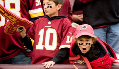 Nate Owen, 8, left, and Jack Dougan, 9, right, of Reston, Va., cheer on the Washington Redskins as they play the Atlanta Falcons at FedEx Field, Landover, Md., Sunday, October 7, 2012. (Andrew Harnik/The Washington Times)