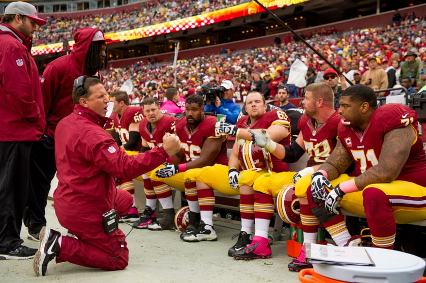 Coaches talk to the Washington Redskins offensive line on the sideline as the Washington Redskins play the Atlanta Falcons at FedEx Field, Landover, Md., Sunday, October 7, 2012. (Andrew Harnik/The Washington Times)
