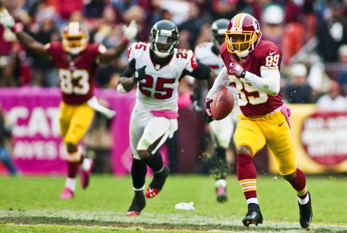 Washington Redskins wide receiver Santana Moss (89) catches a 77 yard pass from quarterback Kirk Cousins (12) for a touchdown in the fourth quarter against the Atlanta Falcons, Landover, Md., Sunday, Oct. 7, 2012.  (Craig Bisacre/The Washington Times)