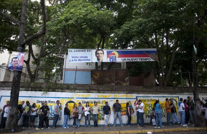 Residents line up at a polling station to vote in presidential elections in Caracas, Venezuela, on Sunday, Oct. 7, 2012. President Hugo Chavez is running against opposition candidate Henrique Capriles. (AP Photo/Sharon Steinmann)