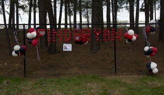 "The message ""Find Bryan"" is written in red plastic cups on a fence outside W.T. Woodson High School along with a flier about missing Woodson senior Bryan Glenn. A body was found off the trail in Thaiss Memorial Park in Fairfax, Va. on Monday, Oct. 8, 2012. Fairfax County Police have not yet determined if it is Glenn, who was last seen Oct. 1 when he dropped his brother off at school and whose car was found in the park's parking lot on Tuesday. A search party set out near 10 a.m. this morning and a small group later found the body. (Barbara L. Salisbury/The Washington Times)"