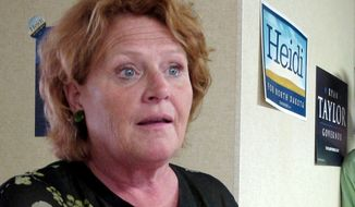 **FILE** North Dakota Senate candidate Heidi Heitkamp speaks Aug. 11, 2012, in Dickinson, N.D. (Associated Press)