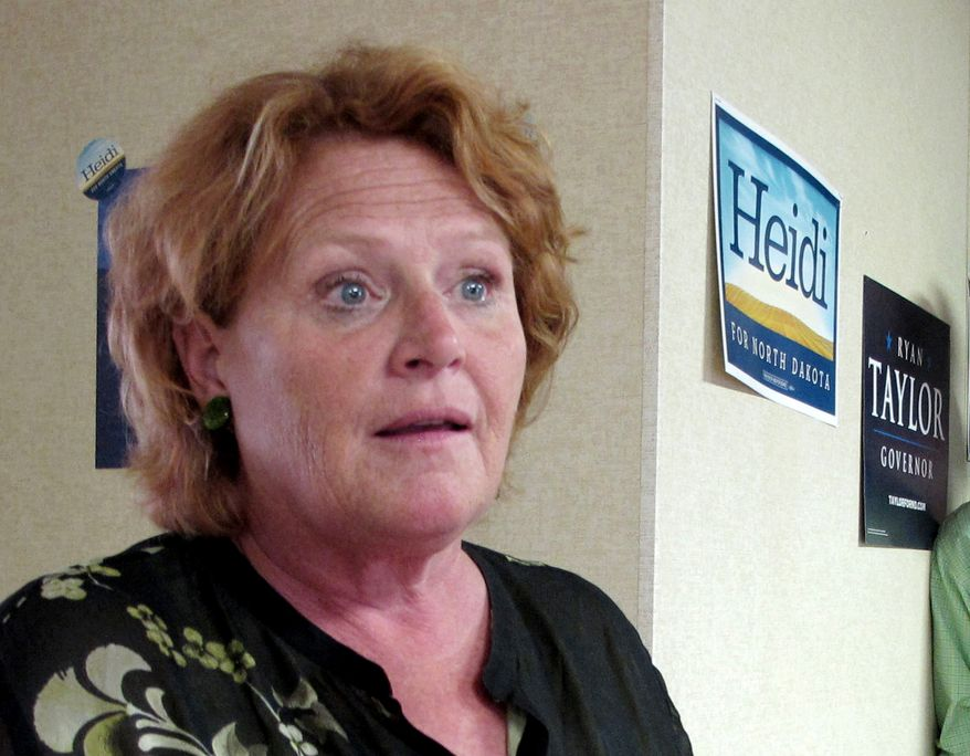 **FILE** North Dakota Senate candidate Heidi Heitkamp speaks Aug. 11, 2012, in Dickinson, N.D. (Associated Press)