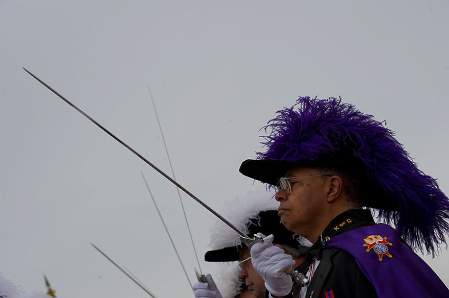 Eddie Oxford Jr., the color corps commander for Washington Assembly 151 of the Knights of Columbus, practices brandishing his sword before the ceremony honoring the 100th anniversary of the National Columbus Memorial outside of Union Station in Washington, D.C. on Columbus Day, Monday, Oct. 8, 2012. (Barbara L. Salisbury/The Washington Times)