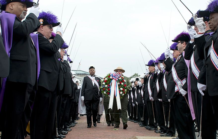 The Knights of Columbus hold their swords out as people present wreaths during a ceremony celebrating the 100th anniversary of the National Columbus Memorial outside of Union Station in Washington, D.C. on Columbus Day, Monday, Oct. 8, 2012. (Barbara L. Salisbury/The Washington Times)