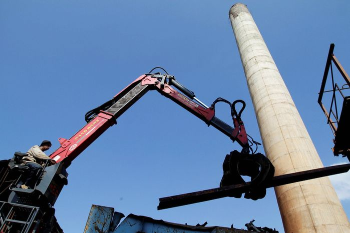 A worker moves iron with a crane during repairs at the Brasil sugar processing plant in Jaronu, Cuba. The plant, launched in 1921, is getting a makeover and expected to be ready in time for the upcoming annual harvest and to start milling cane by February 2013. (Associated Press)