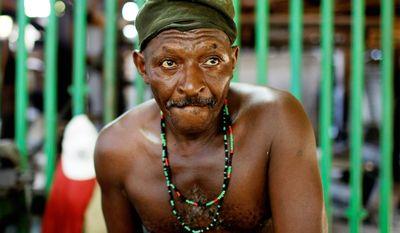 Ernesto Fernandez, 59, works during repairs on the Brasil sugar processing plant in Jaronu, Cuba. (Associated Press)