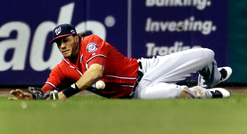 Washington Nationals left fielder Michael Morse cannot catch a ball hit by St. Louis Cardinals' Pete Kozma for a double during the eighth inning. (AP Photo/Jeff Roberson)