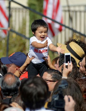 A baby is held up in the crowd Oct. 8, 2012, before President Obama announces the establishment of the Cesar E. Chavez National Monument in Keene, Calif. (Associated Press)