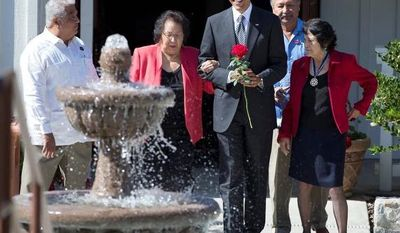 "President Barack Obama holds a special ""Cesar Chavez"" red rose as he walks with Cesar Chavez' widow Helen F. Chavez, second from left, Chavez' son Paul F. Chavez, President of the Cesar E. Chavez Foundation, left, Dolores Huerta, Co-Founder of the United Farm Workers, right and Arturo S. Rodriguez, President, United Farm Workers, as they tour the Cesar E. Chavez National Monument Memorial Garden. (AP Photo/Carolyn Kaster)"