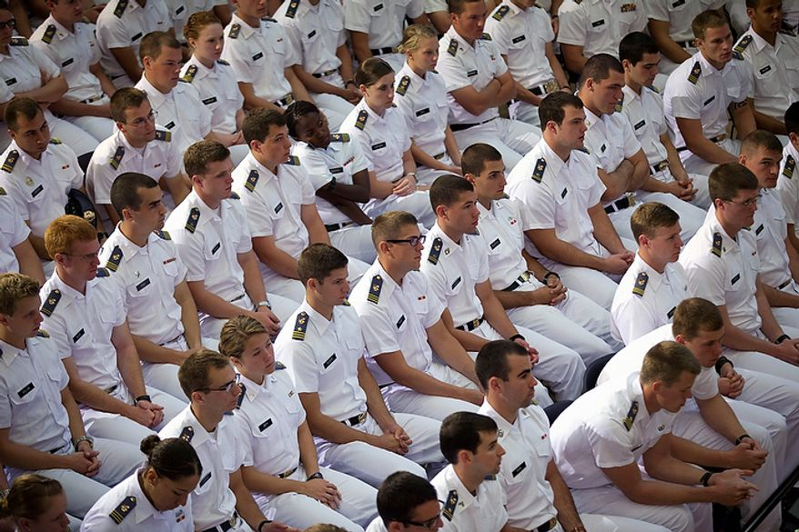 Cadets at the Virginia Military Institute listen to Republican presidential candidate Mitt Romney give a foreign policy speech on Monday, Oct. 8, 2012, in Lexington, Va. (AP Photo/Evan Vucci)