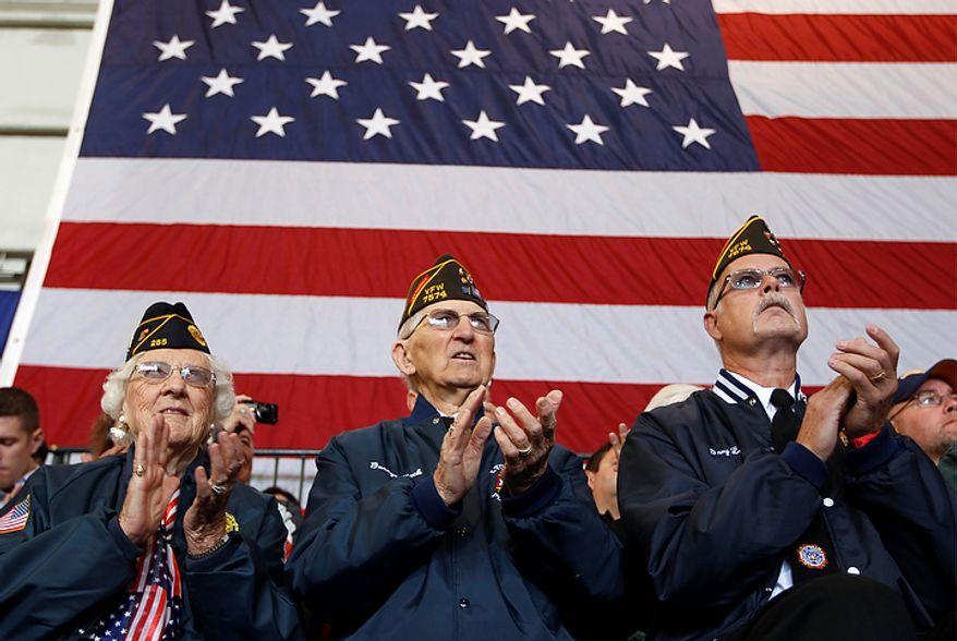 Veterans applaud as Rep. Paul Ryan, the Republican vice presidential candidate, speaks during a campaign event on Monday, Oct. 8, 2012, in Swanton, Ohio. (AP Photo/Mary Altaffer)