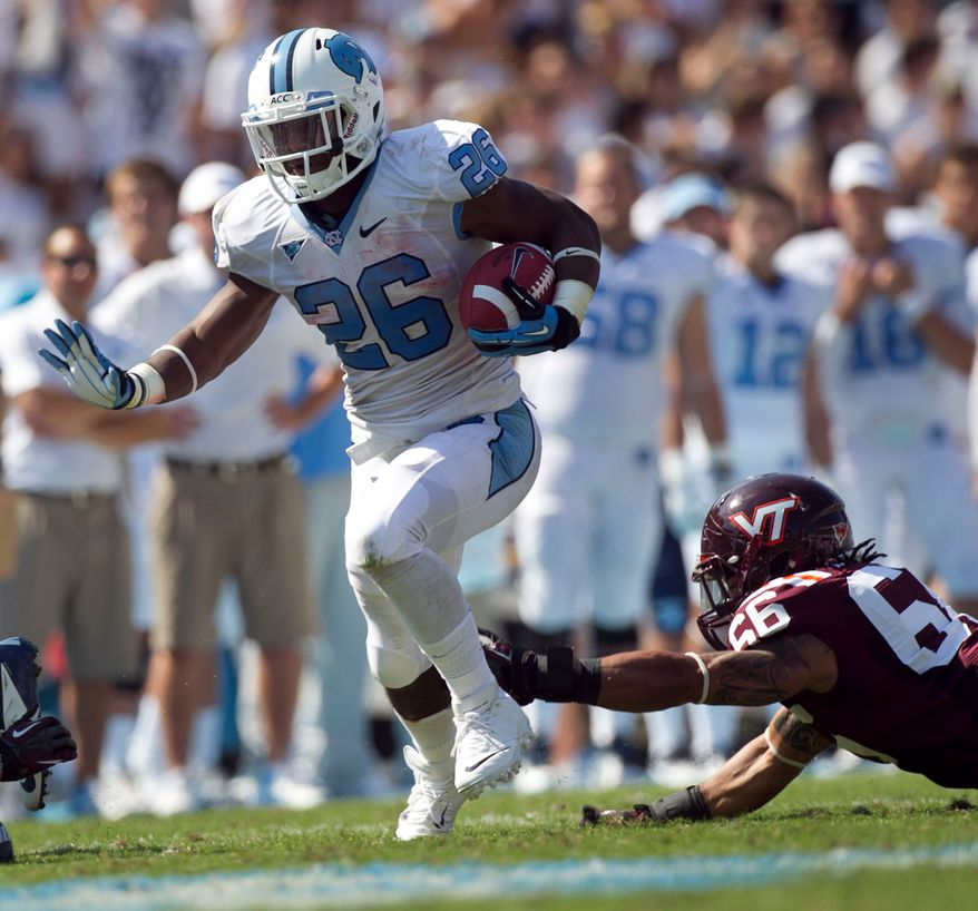 North Carolina's Giovani Bernard (26) breaks away from Virginia Tech's Tyrel Wilson (66) in the second quarter of an NCAA college football game, Saturday, Oct. 6, 2012, in Chapel Hill, N.C. (AP Photo/The News & Observer, Robert Willett)  MANDATORY CREDIT