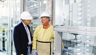 Secretary of the Interior Kenneth L. Salazar visited the Abound Solar Inc. plant in Longmont, Colo., in 2009. The company has filed for bankruptcy, but the Department of Labor says its laid-off employees aren't eligible for federal trade assistance. (Associated Press)