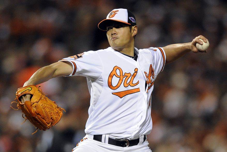 Baltimore Orioles starting pitcher Wei-Yin Chen, of Taiwan, throws to the New York Yankees in the second inning of Game 2 of the American League division baseball series on Monday, Oct. 8, 2012, in Baltimore. (AP Photo/Nick Wass)