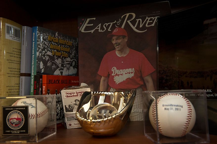 Baseball memorabilia is seen on the shelves in the office of Washington D.C. Mayor Vincent Gray, at the John A. Wilson Building in Washington, D.C., Friday, Oct. 5, 2012. (Rod Lamkey Jr./The Washington Times)