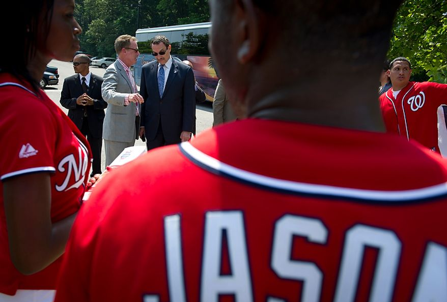 Washington D.C. Mayor Vincent C. Gray (right) chats with Gregory McCarthy (left) Washington Nationals Vice President, Government and Municipal Affairs prior to the Washington Nationals Youth Baseball Academy groundbreaking ceremony at Fort DuPont Park in Washington, D.C., Tuesday, May 31, 2011. (Rod Lamkey Jr./The Washington Times)