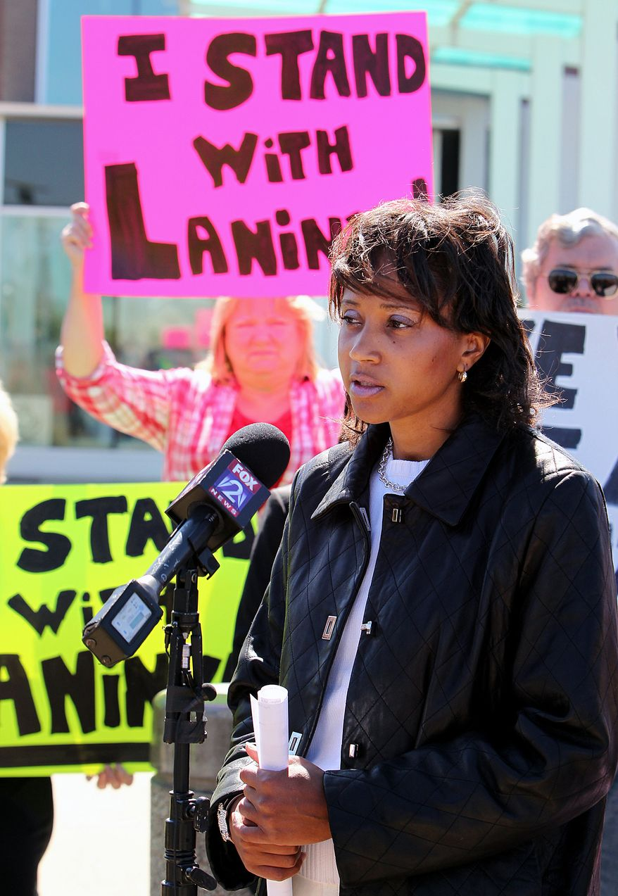 St. Clair County Associate Judge Laninya Cason speaks during a press conference outside the O'Fallon Police Department in O'Fallon, Ill., on Monday, Oct. 8, 2012. (AP Photo/Belleville News-Democrat, Zia Nizami)