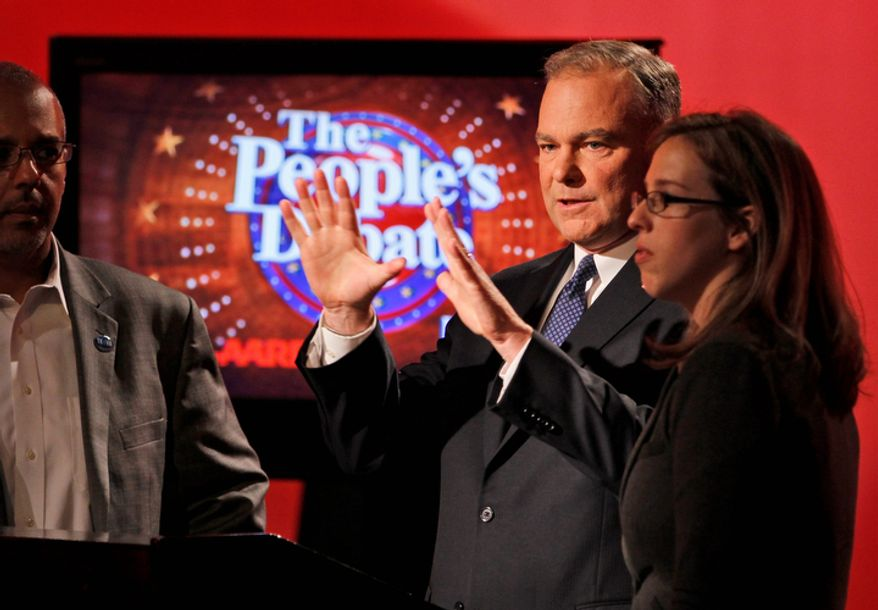 Former Virginia Gov. Tim Kaine talks with his communications director, Brandi Hoffine (right), as he prepares for a debate with his Republican challenger for the Senate, former Sen. George Allen, in Richmond on Monday, Oct. 8, 2012. (AP Photo/Steve Helber)