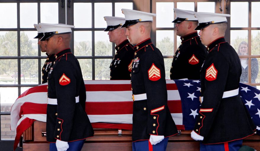 Marine honor guards carry the casket and remains of Marine  PFC James Jacques at Fort Logan National Cemetery in Denver.  (AP Photo/Ed Andrieski)
