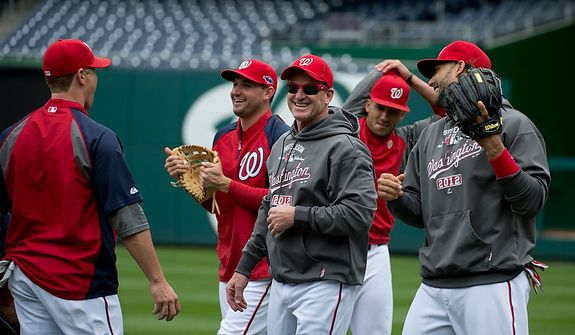 Washington Nationals players laugh and joke during a workout session at Nationals Park on Tuesday, Oct. 9, 2012. On Wednesday, they play the St. Louis Cardinals at home. (Barbara L. Salisbury/The Washington Times)