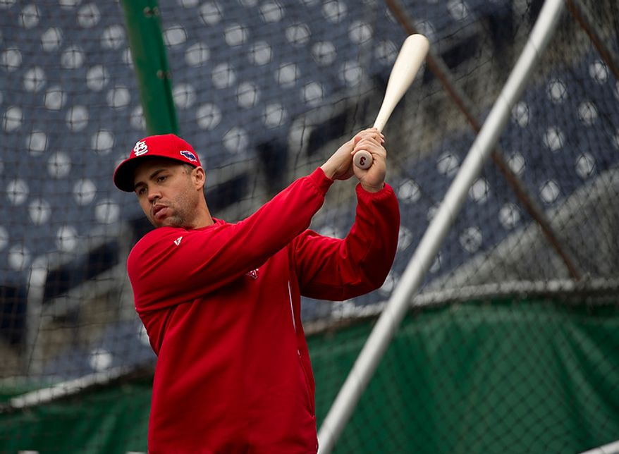 Saint Louis Cardinals player Carlos Beltran swings a bat during a workout session at Nationals Park on Tuesday, Oct. 9, 2012. On Wednesday, they play the St. Louis Cardinals at home. (Barbara L. Salisbury/The Washington Times)
