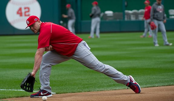 Saint Louis Cardinals player Matt Holliday reaches for the ball during a workout session at Nationals Park on Tuesday, Oct. 9, 2012. On Wednesday, they play the St. Louis Cardinals at home. (Barbara L. Salisbury/The Washington Times)
