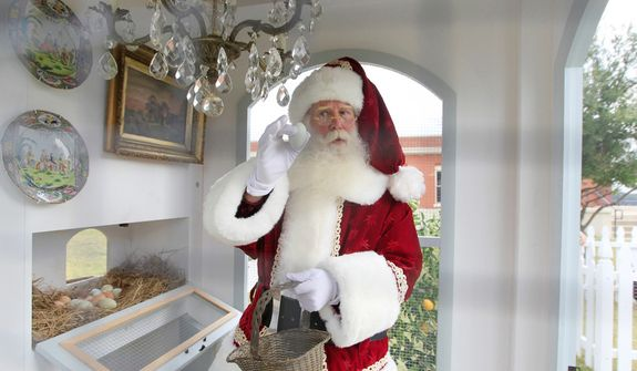 Santa Claus, portrayed by Brady White, gathers an egg from the Heritage Hen House Mini Farm on display during the unveiling of the Neiman Marcus 2012 Christmas Book in Dallas, Tuesday, Oct. 9, 2012. The Versailles-inspired Le Petit Trianon house including the chandelier in the hen house is priced for sale at $100,000.  (AP Photo/LM Otero)