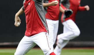 Washington Nationals pitcher Stephen Strasburg throws during batting practice at Nationals Park, Tuesday, Oct. 9, 2012, in Washington. The Nationals are scheduled to host the St. Louis Cardinals in Game 3 of the National League division series on Wednesday. The best-of-five games series is tied 1-1. (AP Photo/Alex Brandon)