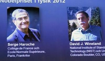 Photographs of the 2012 Nobel Prize laureates in Physics Serge Haroche from France, left, and David Wineland from the U.S. are presented on a screen during a media conference at the Royal Swedish Academy of Science in Stockholm, Sweden, Tuesday Oct. 9, 2012. (AP Photo/Bertil Enevag Ericson/SCANPIX)