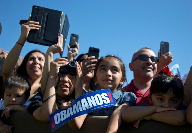 Members of the audience look to the stage as President Obama speaks at the Cesar E. Chavez National Monument on Monday, Oct. 8, 2012, in Keene, Calif. (AP Photo/Carolyn Kaster)