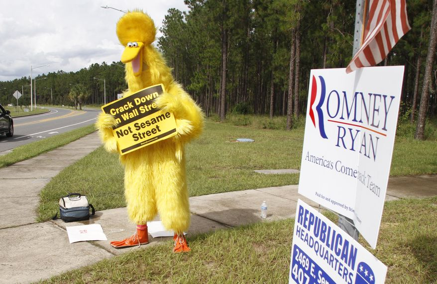 **FILE** A protester dressed as Big Bird stands Oct. 6, 2012, outside of the amphitheater in Apopka Fla., where Republican presidential candidate Mitt Romney prepares to speak during a campaign rally. (Associated Press)