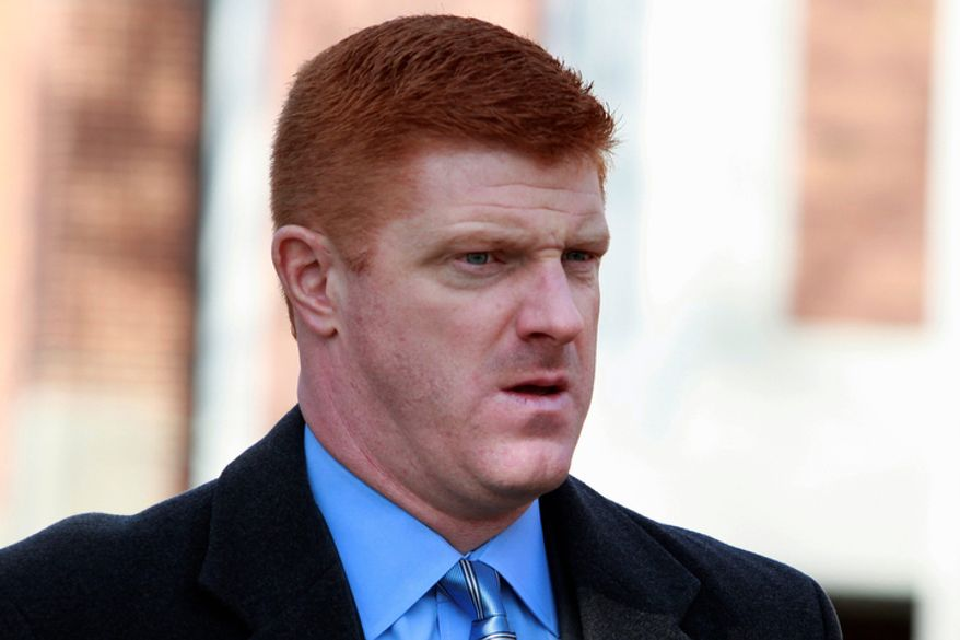 **FILE** Former Penn State assistant football coach Mike McQueary arrives Jan. 25, 2012, at the Pasquerilla Spiritual Center on the Penn State campus for the funeral service of former Penn State football coach Joe Paterno in State College, Pa. McQueary, the former Penn State graduate assistant who says he saw former assistant football coach Jerry Sandusky showering with a boy in 2001 and testified against him, has sued the university for what he says is defamation and misrepresentation. (Associated Press)