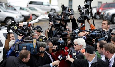 **FILE** Pennsylvania senior Deputy Attorney General Joseph E. McGettigan III speaks with members of the media after a pre-sentencing conference on Oct. 8, 2012, outside the Centre County Courthouse in Bellefonte, Pa. Former Penn State University assistant football coach Jerry Sandusky was scheduled to be sentenced the next day for sexually abusing 10 boys in a scandal that rocked the university and brought down coach Joe Paterno. (Associated Press)