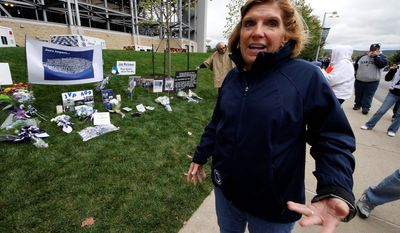 **FILE** Gayle Barnes, a member of the jury that convicted former Penn State assistant football coach Jerry Sandusky, stands Oct. 6, 2012, outside Beaver Stadium in State College, Pa. Sandusky was convicted in June of molesting several boys over a period of years. Barnes, a homemaker and former school district employee, said she thinks a lot about the victims, particularly the eight who testified against Sandusky and provided what she considers the critical evidence of guilt. She said he deserves life in prison. (Associated Press)