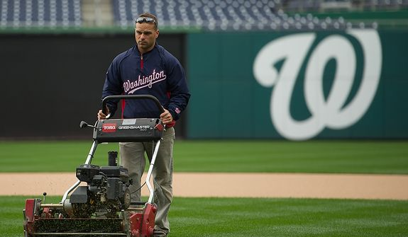 Head Grounds Keeper John Turnour gets ready for game 3 at Nationals Park where the Washington Nationals will take on the St. Louis Cardinals in the first round of the Major League Baseball playoffs, Washington, D.C., Monday, October 8, 2012. (Andrew Harnik/The Washington Times)