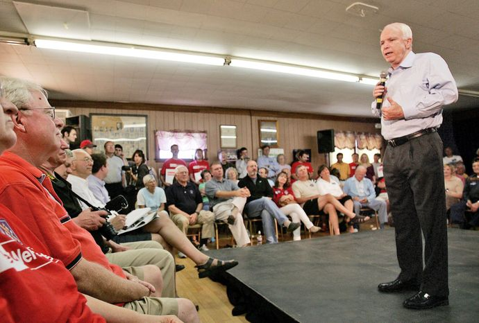 Republican presidential hopeful U.S. Sen. John McCain, of Arizona, talks to a crowd, including Jean and Frank Fahey, left, during a campaign stop in Claremont, N.H., Saturday, July 14, 2007. (AP Photo/Jim Cole)
