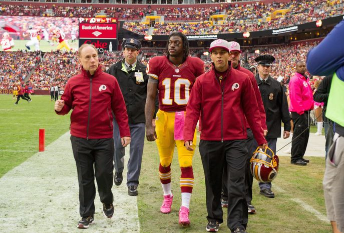 andrew harnik/the washington times Redskins quarterback Robert Griffin III was taken to the locker room Sunday after suffering a concussion on a hit from Atlanta linebacker Sean Weatherspoon. Griffin returned to practice Wednesday.