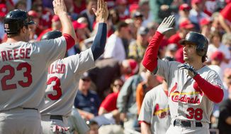 St. Louis shortstop Pete Kozma (right) celebrates with teammates Wednesday as he crosses the plate after hitting a three-run homer in the second inning. (Andrew Harnik/The Washington Times)