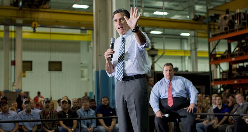 Republican presidential candidate Mitt Romney makes a point Wednesday at a campaign rally in Mount Vernon, Ohio, as New Jersey Gov. Chris Christie looks on. (Associated Press)