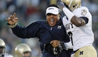 Navy head coach Ken Niumatalolo, left, reacts with safety Emmett Merchant following a turnover by Notre Dame during the third quarter of an NCAA college football game in South Bend, Ind., Saturday, Nov. 7, 2009. (AP Photo/Darron Cummings)